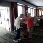 Our greeter and resident, Ellen, always enjoys helping and putting Lei's on others at our Patio Party.