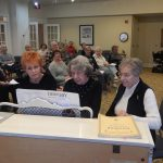 Resident, Diane Koenig (pictured in the middle), along with her former students, entertained the residents with some of their old time favorites.